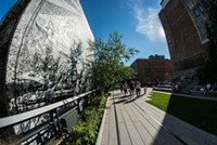 People walk on the High Line, an elevated greenway in New York City.