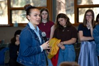 Mia Hladysh, 16, speaks to a crowd of students during the National Walk Out event held at Unitarian Universalist Fellowship on April 20, 2018. At 10am, students across the nation participated in the National School Walkout to end gun violence.