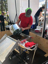 Owner of Crazy Cajun Crawfish Company, Logan Kelley, putting a batch of crawfish in to boil - Uploaded by Merissa Kelley