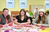 PHOTO BY SHERRON LUMLEY - Valentines for Veterans: From left, Ashley Fowler, Laura Thompson and Katie Uselman make valentines for wounded veterans.