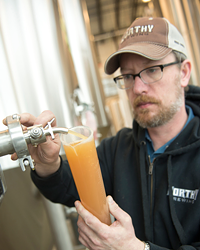 Worthy brewmaster Chad Kennedy samples the latest in hop science.