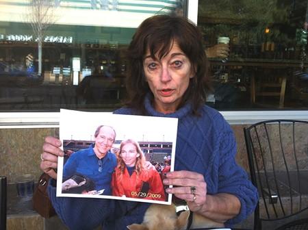 A BROKEN HEART Houston Herczog's mother, Marilyn, holds a photo of Mark and Houston Herczog at Houston's 2009 graduation. - RACHEL DOVEY