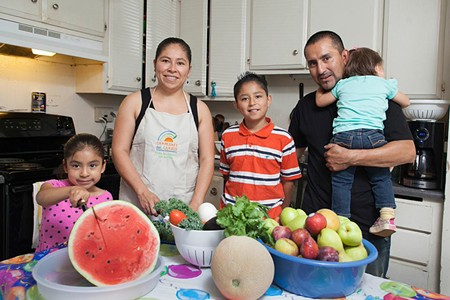A FRESH START Roseland's Alejandra Sarmiento, second from left, has helped put her family on a healthier track with fresh food and exercise. - MICHAEL AMSLER