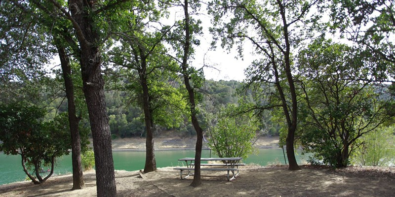 Lake Berryessa A picturesque picnic area sits idle on the west shore of Lake Berryessa.