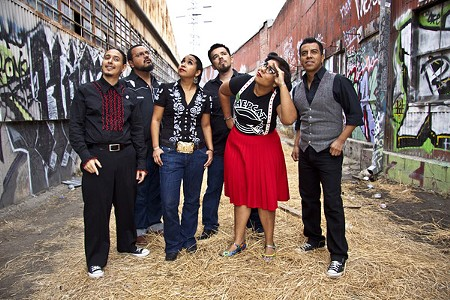 ADIOS, 2011! La Santa Cecilia open a blowout night with comedian Gabriel Iglesias and get-down heroes Ozomatli at the Uptown Theatre in Napa.