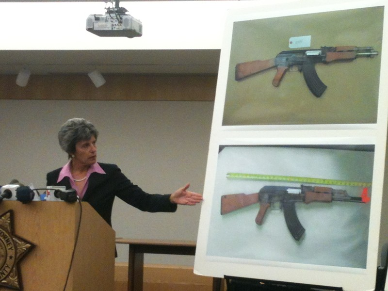 At Monday's press conference, Sonoma County District Attorney Jill Ravitch compares two toy guns.