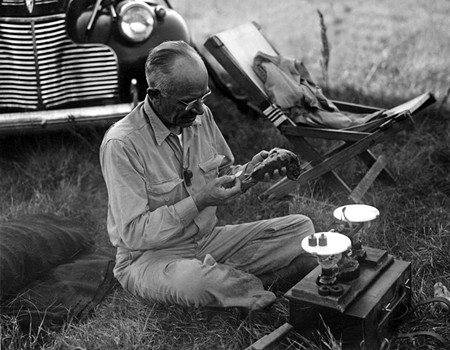 BIRD MAN Outdoorsman and avid hunter Leopold gamely cleans a woodcock on hunting day. - COURTESY ALDO LEOPOLD FOUNDATION