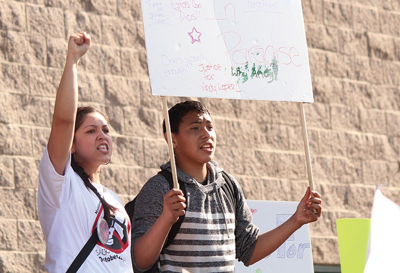 CALLING FOR JUSTICE Darlene Arechiga and Andres Beltran at a march for Andy Lopez outside the sheriff's office. - NICOLAS GRIZZLE