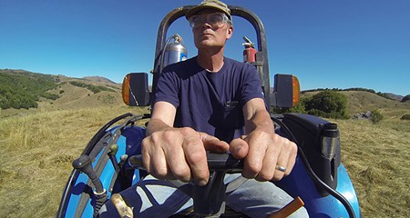 CARBON FARMER Nicasio rancher and Marin Carbon Project cofounder John Wick spreads compost over his land. - GREG RODEN
