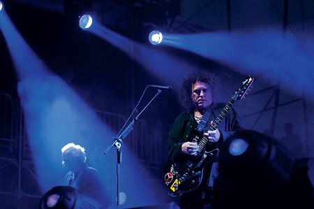 CURED Robert Smith lays into a tune during the band's two-and-a-half-hour show. - KATIE STOHLMANN