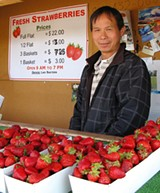 DAILY SPECIAL: Note the hand-changed prices at Lao Saetern's stand—lowered, not raised.