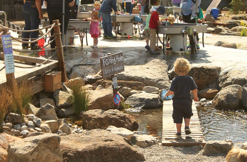 DOWN BY THE RIVER  A model of the Russian River beckons a young visitor at the Children's Museum of Sonoma County.