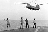 EPIC FAIL Aboard the USS Kirk, crew members signal a Chinook helicopter to hover over the deck and drop its passengers out.