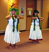 HULA MAI - Faye Brown (L) and Celina Hall (R) dance part of the legend of Pele, Hawaii's volcano goddess.