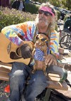 <b>FEELING TIPSY</b> Peter Romanowsky plays guitar with Diamond Dog at the Ferry dock.