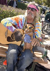 FEELING TIPSY Peter Romanowsky plays guitar with Diamond Dog at the Ferry dock. - MICHAEL AMSLER