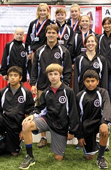 Freddie Myles, center, with his 2013 youth weighlifting teams at the national championships in Missouri