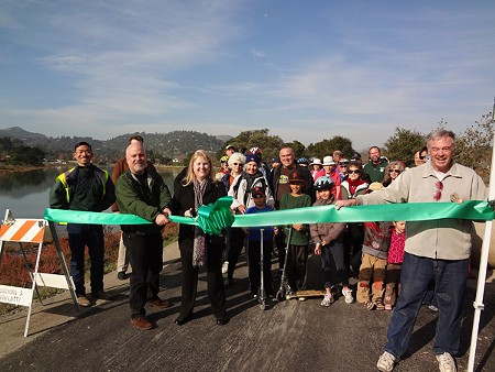 GREEN RIBBON Members of the RVSD open a new trail and sewer pipe along Corte Madera Creek in December 2011.