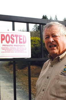 HIDDEN ACTIVITY: Jim Doerksen at the gate to Cornell's proposed winery, where unpermitted tree and brush removal has caused harmful erosion to a creek once teeming with salmon.