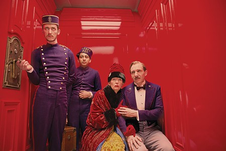 HOTEL SKULLDUGGERY Tilda Swinton and Ralph Fiennes (right) take a quirky ride in Wes Anderson's hotly anticipated new film.