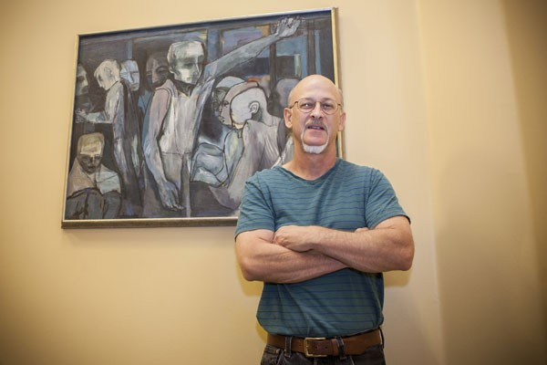 IN CIRCULATION Curator Scott Lipanovich, with Maurice Lapp's 'The Travelers.' - SARA SANGER