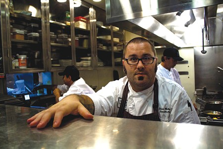 INVITATION TO INDULGE Chalkboard chef Shane McAnelly, working wonders with the old Cyrus kitchen. - NADAV SOROKER
