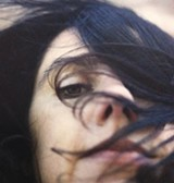 LAST LIVING ROSE PJ Harvey's record takes getting used to; then, love ensues.