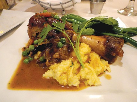 MAIN COURSE The lamb shank over polenta at Riviera is exemplary of the restaurant's approach—simple dishes done right. - NICOLAS GRIZZLE