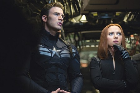 MAN IN A UNIFORM Chris Evans wonders what could be more interesting to Scarlett Johansson than his chiseled looks in 'Captain America.'