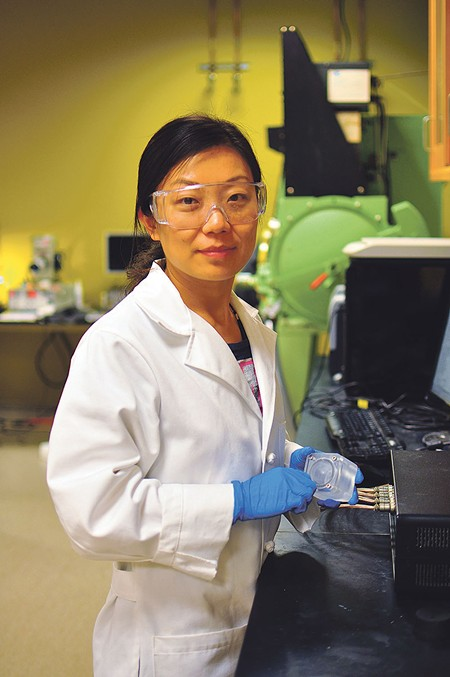 MICROBIAL PROCESSING UCSC's Hanyu Wang worked on the new solar-microbial device for generating hydrogen fuel. - SONG YANG