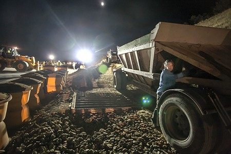 NIGHT WATCH Peggy Backup, from Redwood Valley, locked herself to a hauling trailer last month. - REE SLOCUM