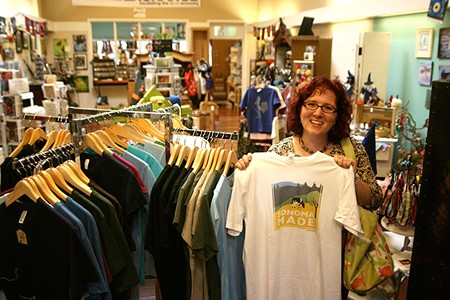 NORTH BAY EMPORIUM Adriann Saslow, maker-associate at the Made Local Marketplace, shows off some of the shop's many worthy wearable wares. - ELIZABETH SEWARD