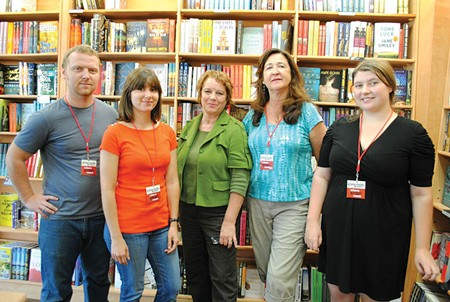 PAGE TURNERS Vicki DeArmon, center, Copperfield's events and marketing director, says her staff helps make bestsellers. - JESSIE JANSSEN