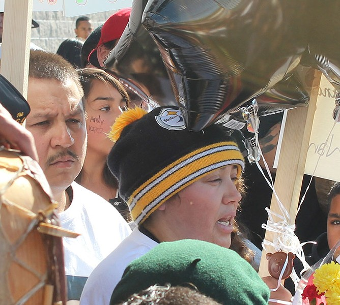 PARENTS' LOSS Rodrigo and Sujey Lopez at a recent rally in Santa Rosa. - NICOLAS GRIZZLE