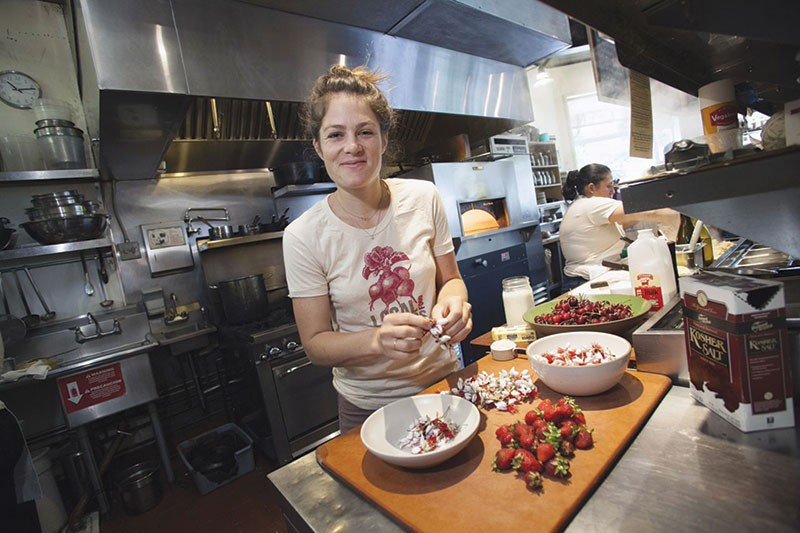PETAL POWER Peter Lowell's chef Natalie Goble works with pineapple guava blossoms from a backyard grower. - MICHAEL AMSLER
