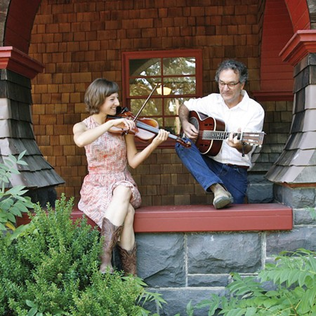 PICKIN' AND GRINNIN' Musicians Dan Imhoff and Yvette Holzwarth met at a benefit show.