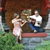 <b>PICKIN' AND GRINNIN'</b> Musicians Dan Imhoff and Yvette Holzwarth met at a benefit show.