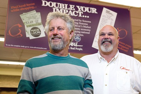 PROVING RESULTS Steve Maass and Tom Scott of Oliver's Market, which participated in a report on shopping locally. - MICHAEL AMSLER