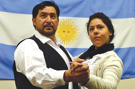SEE 'EM BOTH Ana Laura Nicolicchia (above, with Pedro Rodelas as Che) and Laura Post alternate in the title role of 'Evita.'