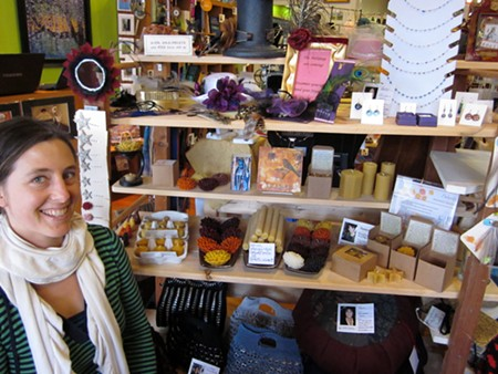 SHE'S CRAFTY Carrie Redfern at the Made Local Marketplace with a cross-section of locally made gifts. - LEILANI CLARK