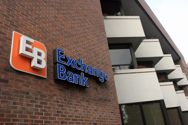STILL WAITING Confidence in the economy is hard to quantify, say Exchange Bank executives, and any reinstatement of the Doyle Scholarship 'will certainly not be this year.'