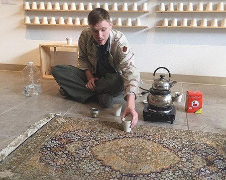 SWEET TEA Aaron Hughes learned that in Iraq, sharing tea is part of a social contract. - DREW CAMERON