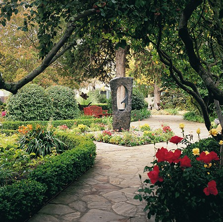 TAKE A STROLL MacArthur Place's grounds are filled with gardens and art.