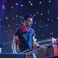 BottleRock Napa Valley 2014 The Cure's bassist Simon Gallup is easily the most punk rock member of the band. Katie Stohlmann