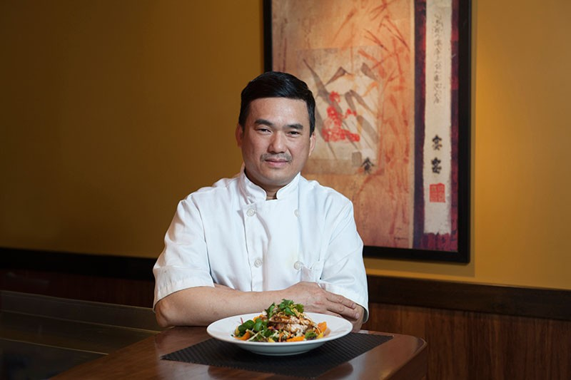 THE WOK MASTER Michael Ly holds down the Cantonese fortifications at Eight - MICHAEL AMSLER