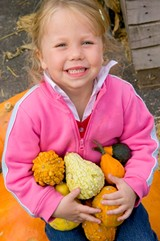 19fe1267_girl_with_pumpkins_stock-lr.jpg