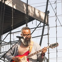 BottleRock Napa Valley 2014 TV on the Radio guitarist Kyp Malone keeps the rhythm going during the band's impressive Day One BottleRock set. Katie Stohlmann