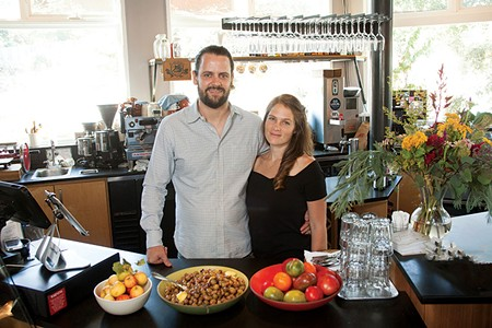 HERE'S A TIP Lowell Sheldon, left, and Natalie Goble hope to inspire customers and staff with their new policy. - MICHAEL AMSLER