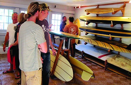 BOARD ROOM Visitors to the Bolinas Museum check out vintage surfboards in a recreation of the Bolinas Surf Shop.