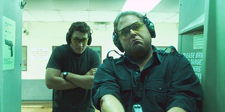 TWO PERSON SHOOTER  Miles Teller, left, and Jonah Hill score few funny points in strange comedy from Todd Phillips.